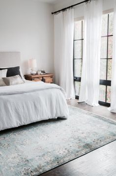 Love The Idea Of A Statement Rug. Love The Wood   Light, Airy Bedroom.  White Sheets And Drapes, Light Blue Persian/Oriental Rug