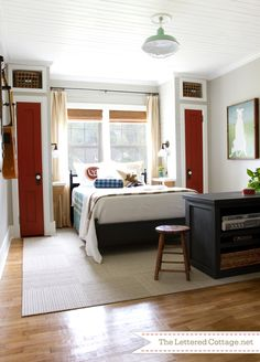 Plank walls, BM Burnt Peanut Red 2081-10 closet doors, SW Roycroft Mist Gray walls, Graphite desk
