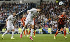Cristiano Ronaldo of Real Madrid heads the ball to score his team's fourth goal during the UEFA Champions League Group A match between Real Madrid CF...