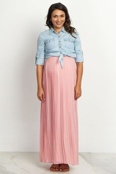 Don't miss out on one of the hottest styles this season. This high waisted maternity maxi skirt features gorgeous pleats that look beautiful paired with any crop top and wedges. Complete your look with a statement necklace or beaded headband for a stunning ensemble.