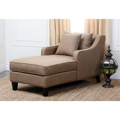 Stretching out and reading a book will be even more enjoyable when you recline on this upholstered wooden chaise lounge. The taupe color matches well with virtually any color scheme, and two accent pillows are included to ensure a completed look.