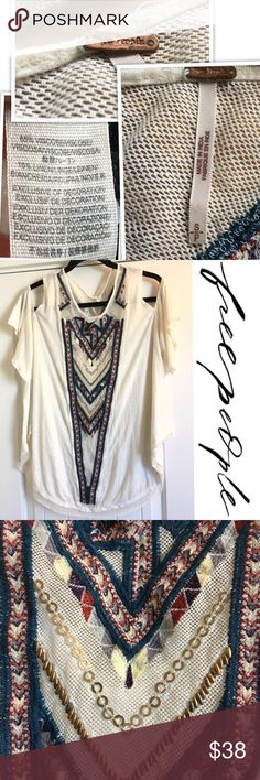 Freepeople Cold shoulder Embroidered, beaded tunic Free people cream cold shoulder top embellished with gold colored beads along with navy and red embroidered design. The unfinished hem edges give it the live in look. 85% Viscose 15% Linen Previously owned . Condition is shown in photos. Colors may vary due to lighting.  💐Bundle & Save💰 Thanks for shopping my closet💕💕 Free People Tops Tunics