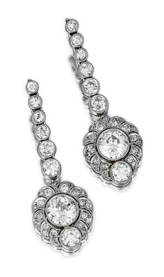 PAIR OF DIAMOND EARRINGS, CIRCA 1920.  Each millegrain-set with a circular-cut diamond within a pierced scalloped frame of circular-, single- and rose-cut stones, suspended from a graduated line of collet-set diamonds,   with case signed Rath, Munchen.