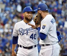 Kansas City Royals relief pitcher Kelvin Herrera was all smiles as he talked to third baseman Mike Moustakas after Herrera shut down the Blue Jays in the eighth inning during Saturday's ALCS baseball game on October 17, 2015 at Kauffman Stadium in Kansas City, Mo.