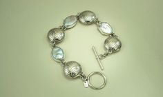 Bracelet. Sterling silver hollow form beads and white freshwater pearls.