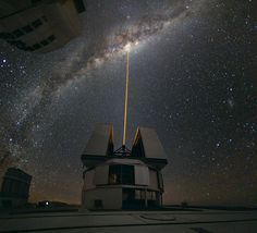 Yepun's laser beam crosses the majestic southern sky and creates an artificial star at an altitude of 90 km high in the Earth's mesosphere. The Laser Guide Star (LGS) is part of the VLT's adaptive optics system and is used as a reference to correct the blurring effect of the atmosphere on images. The colour of the laser is precisely tuned to energise a layer of sodium atoms found in one of the upper layers of the atmosphere — one can recognise the familiar colour of sodium street lamps in…