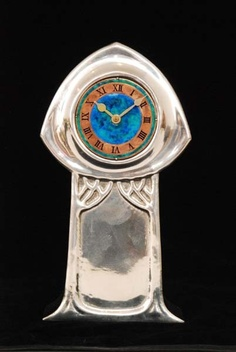 Archibald Knox - Liberty & Co - A Tudric polished pewter mantle clock #clock