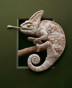this Chameleon is a sculpture made out of coloured paper. Award-winning Canadian artist Calvin Nicholls painstakingly makes his sculptures out of cut slivers of paper. Each sculpture takes him from a month to two years to make. Paper Book, 3d Paper, Paper Lace, Kirigami, Nature Paper, Animal Sculptures, Paper Sculptures, Paper Animals, Book Sculpture