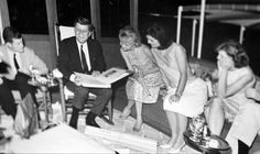 Family members celebrate President John Kennedy's 46th birthday aboard the Sequoia. Ted Kennedy is at his right, Jackie Kennedy is second from his left, and Eunice Shriver is third from his left.