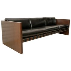 Cantilevered Walnut & Leather Sling Sofa | From a unique collection of antique and modern sofas at http://www.1stdibs.com/furniture/seating/sofas/