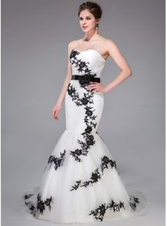 Can be changed to champagne with ivory embellishments and sash