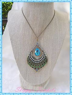 Im a big fan of peacock feathers ~ so beautiful which is the inspiration of this pendant necklace.    The chain measures 22 inches in length and