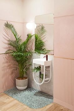 A pink bathroom Perhaps the least assuming of rooms, even the most tonal of homes can make room for a statement bathroom. Employ the house of an indoor plant to freshen the space and add contrast. Photographed by Damian Bennett