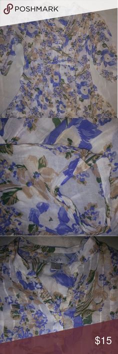 Ann Taylor Loft three-quarter sleeve blouse Beautiful light Floral Pattern cream background with beautiful lavender Blues greens and light brown ruffle detail down the bust buttons .mock collar tie in the back of the shirt adorable for summer 32 inches in length 15 across Ann Taylor Tops Button Down Shirts