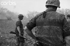 10 Jan 1968, Da Nang, South Vietnam --- Here, a U.S. Marine has cynical, but humorous, slogans written on his jacket and helmet.  This marine was in a battle, fighting North Vietnamese Regulars about 20 miles south of Da Nang. --- Image by © Bettmann/CORBIS