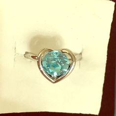 Dainty Platinum Blue Auden Crystal Heart Ring ‼️CLEARANCED‼️ PERFECT GIFT FOR CO WORKERS OR FAMILY!!! I sold these for $35 & they sell retail for $65!! Lead & Nickel Free! Deluxe gift box too! REAL PLATINUM NOT FAKE PAINTED!! Beautiful Swarovski blue Auden Crystal. Platinum plated. I also have matching earrings💕 VERY high quality item.  Stock # 009.         I ALWAYS gift wrap and send a free surprise gift too🎁💝 Bundle w/ @missrochelles2 to save on shipping📬 Jewelry Rings