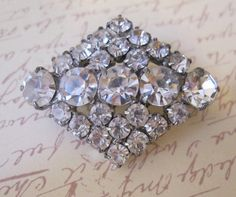 "Beautiful bridal brooch would be beautiful as a hairpiece! Vintage clear sparkling Rhombus brooch. Diamond shape brooch is 1 3/4"" x 1 1/4"". Perfect for your wedding, these make great hair accessories."
