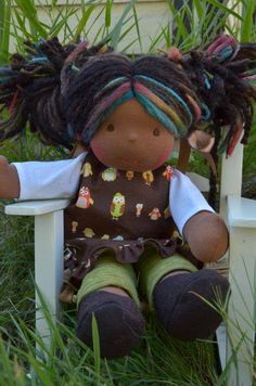 This is Keira, a Bamboletta Sitting Friend from the September 12, 2014 upload.  She has dark skin, long hair made with mohair and wool yarns in a black and dark brown color with multicolored fairy bits and brown eyes.  She is wearing the pictured outfit, underpants and wool felt shoes.