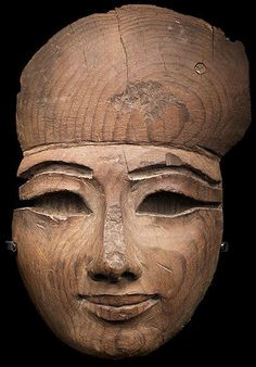 Egyptian wooden mummy mask dated to the 22nd Dynasty (c. 945-715 B.C.)