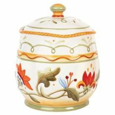 "Keep snickerdoodles and other treats on hand with this charming cookie jar, crafted from ceramic and featuring a floral motif.   Product: Cookie jarConstruction Material: CeramicColor: MultiDimensions: 9.75"" H x 6.75"" Diameter"