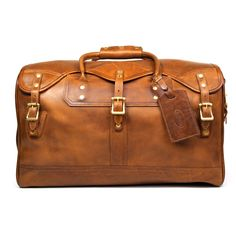 I love the clean, classic lines of this carry-on.  Very chic.  Leather Duffle/Duffel Bag Carry-on - Small, Distressed Leather | J.W. Hulme Co.
