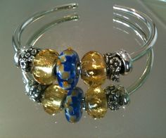 The New Trollbeads Bangle is the easiest to use and so much fun to switch around daily! http://www.trollbeadsgallery.com/bangle/