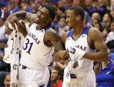 Kansas' Wayne Selden (1) holds back teammate Jamari Traylor as Traylor celebrates a bucket by reserve Christian Garrett in the final moments against Fort Hays State on Tuesday, Nov. 5, 2013. #KU