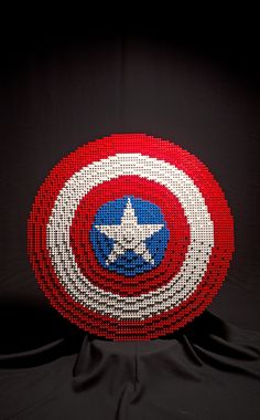 Captain America shield, the lego one. (The Soldier by buriedbybricks, via Flickr). This guy built all of the Avengers weapons!