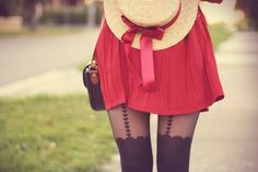 Those tights are to die for, and the color of that skirt is heaven!