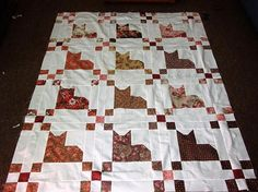 Unfinished Quilt 48x62  Featuring cat quilt blocks Fabric colors include...browns, beige, pinks , maroon, gold......background fabric is a solid ivory  These quilt tops are made to order Completion takes 4-6 weeks