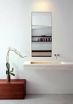 I like the idea of the faucet not being right below the mirror, where the mirror gets splattered more often.