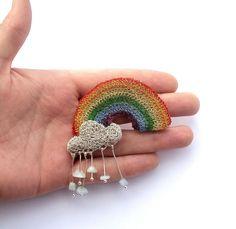Crochet rainbow brooch with aqamarine stone raindrops falling from a cloud