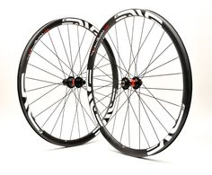 Precision handcrafted ENVE 29er XC carbon rims with DT Swiss 240s center lock disc MTB hubs, black DT aerolite bladed spokes, and alloy nipples. 1431g.
