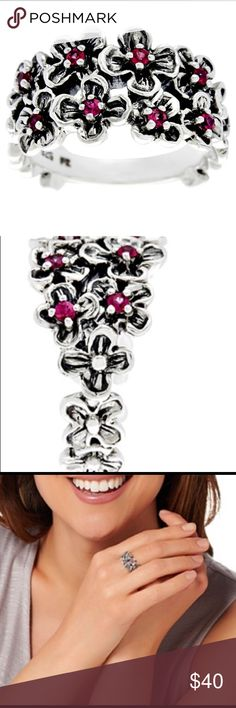 """New  Or Paz silver gemstone ring New beautiful Or Paz sterling silver and Ruby gemstone flower ring. Multiple oxidized flowers decorate the front with a round gemstone  placed in the center of each one. Made in Israel. 1'2"""" by 3/4"""" Or Paz Jewelry Rings"""
