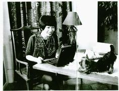 Amy Tan at her desk with our Moroccan Monkey Lamp