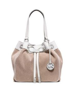 ab9ac0a731ad Stunning MICHAEL Michael Kors Marina Large Drawstring Tote constructed from  washed cotton canvas with contrasting white