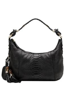 """Black python with black leathertrim  light gold hardware  single non-adjustable strap with 9.8"""" drop  zip-top closure  luggage tag  inside zip, cell phone, and pda pocket  cotton linen lining  15.7""""L x 6.7""""W x 11.8""""H"""