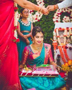 Gracious Bride Adorn with Eye Catching Blue and Pink Contrast Colour Saree. Bridal Sarees South Indian, Bridal Silk Saree, South Indian Bride, Indian Bridal Fashion, Silk Saree Blouse Designs, Bridal Blouse Designs, Pattu Sarees Wedding, Kanchipuram Saree Wedding, Saree Dress