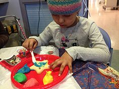 Children's hospital patients decorate cookie, make crafts with the Frosting Queens