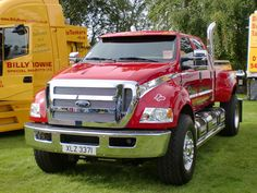 Ford F650 I know I'd look awkward with my little self in this big truck but I WANT ONE!!!!!