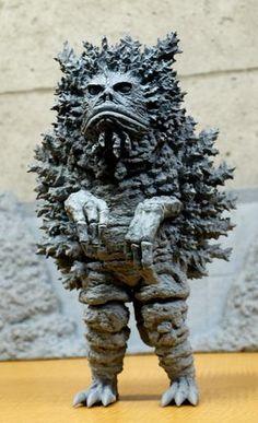 "The kaiju eiga (literally ""monster movie"" in Japanese) was born in 1954 with Ishiro Honda's landmark masterpiece Godzilla. Its immense international success… Sculptures, Lion Sculpture, Japanese Monster, Scary Monsters, Mecha Anime, Monster Design, Vintage Horror, Creature Feature, Vintage Japanese"