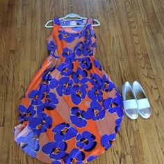 cute spring/summer Romeo and Juliet couture dress! A very cute floral midi dress! Orange with purple floral pattern! The material is silky . The dress is brand new in perfect condition and perfect for spring and summer! Romeo & Juliet Couture Dresses Midi