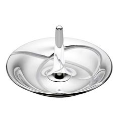Keep your favorite rings within reach with this Lenox Adorn ring holder. Made of silver plated metal, this ring holder attractive accent piece for your dresser or nightstand. Simply slip the rings off your fingers and onto the cone at the center of this jewelry storage dish.