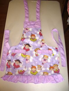 Purple Little Girl Apron,  covered in cute fairies, and Princess embroidered at the top!