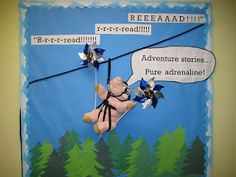 """Lorri's School Library Blog -Maxwell is really saying """"read"""" on that zip line. Library bulletin board."""