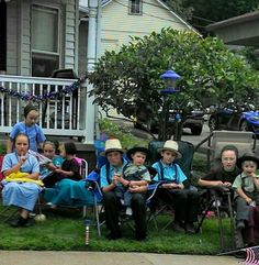 Amish kids enjoying their candy....they collected during the parade, Millersburg, OH