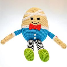 A wonderful Crocheted Humpty Dumpty, handmade by the ladies of Hathay Bunano in Dhaka, Bangladesh. Part of the 'Pebble' range of baby toys, he has a Red Bowtie, Blue Shirt, Black & White Striped Leggings and Green Boots. And a white bandage on his head.  Machine washable - Suitable from birth  Height : 390mm Width : 150mm Depth : 100mm Legs : 200mm Arms : 140mm