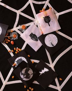 Play with the notion of positive and negative space by layering black and white paints -- in spooky shapes, of course -- on black and white goody bags.