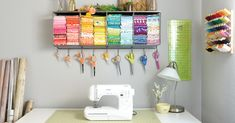 Turn a boring workspace into a bright and colorful sewing corner! Tips for storing fabric, organizing ribbon, and making it all look beautiful. #ad
