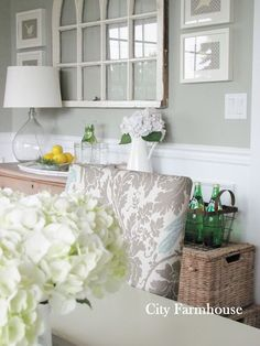 Dining Room - love that vintage window flanked by 4 prints